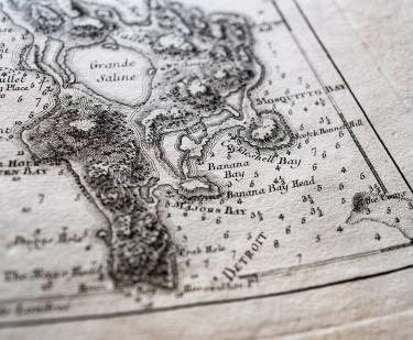 "Detail of a printed map shows Detroit with labels reading ""Grande Saline,"" ""Mosquitto Bay,"" and so on."