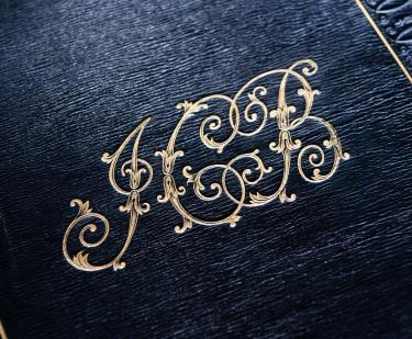 Detail of gold JCB stamp on black binding.
