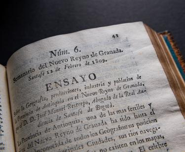 "Detail from a printed book shows text in Spanish including ""Ensayo"" at the top of the page."