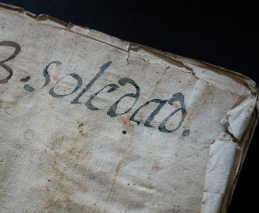 "Detail from the binding of a manuscript codex shows text in Spanish ""3. Soledad."""