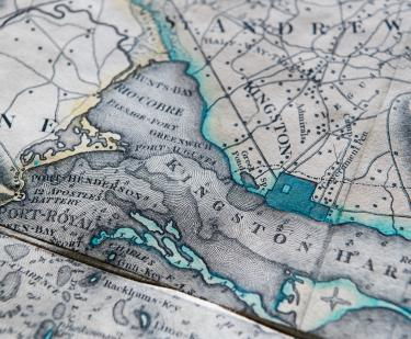 Detail of an engraved, colored map of Jamaica shows Kingston Harbor outlined in a greenish blue color and St. Andrew. Other surrounding locations labeled in English.