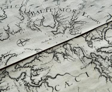 "Detail of an engraved map of Virginia and Maryland shows ""Baltemore county,"" a compass rose, and labels in English."