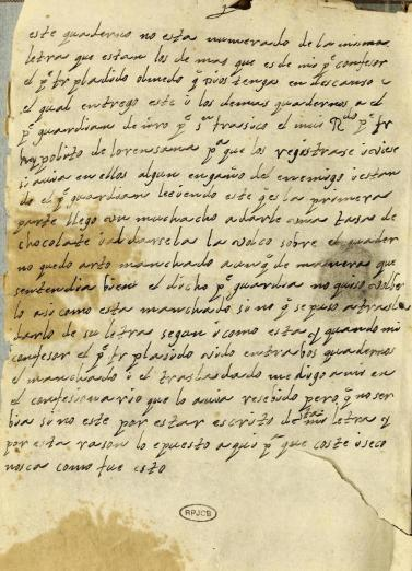 manuscript Spanish text stained with chocolate beverage