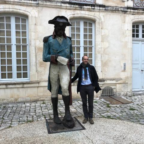 John Carter brown library director Neil Safier next to statue of toussaint louverture