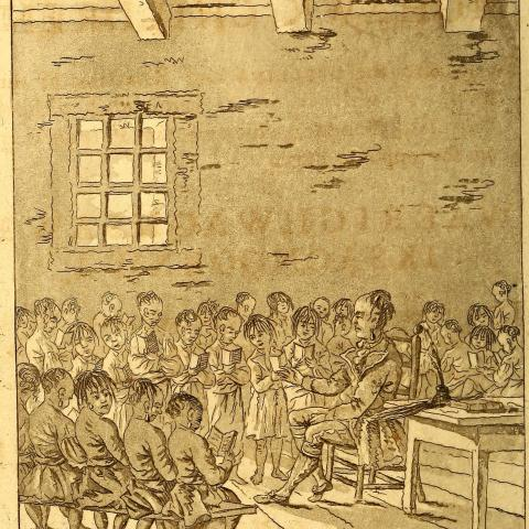 a Mohawk man teaches children in a schoolhouse