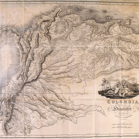 Printed fold-out map shows topography of Colombia in great detail. Includes decorative cartouche, illustration of two naked people sitting facing each other, and scales.