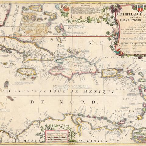 colorful map of Caribbean islands with decorative cartouche