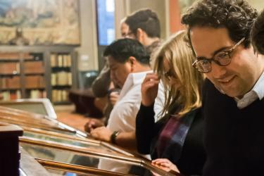 JCB Fellow Juan Cobo Betancourt views an exhibition at the John Carter Brown Library